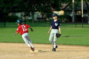 Boys Baseball Runner Rounds Second Base 604844