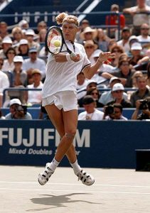 FILE -- Steffi Graf, of Germany, leaps in the air to return the ball to second seed Monica Seles of Sarasota, Fla., during the women's singles final at the U.S. Open in New York Sunday, Sept. 8, 1996. Graf, one of just five players to complete the tennis Grand Slam in one year and a dominating force for more than a decade, retired from the sport Friday August 13, 1999, saying her ``motivation wasn't what it was in the past.'' (AP Photo/Kathy Willens)